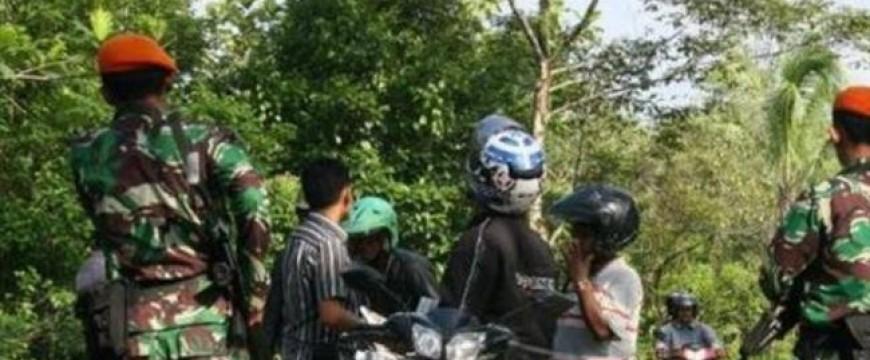 Two policemen, guard shot dead near US mine in Indonesia