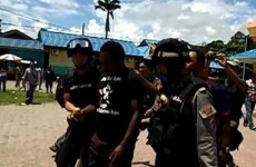 "West Papuan journalist John Kuayo arrested by Indonesian police for wearing a ""Free West Papua"" t-shirt"